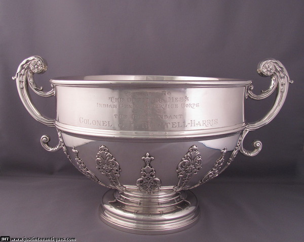 A massive Edwardian sterling silver punch bowl, hallmarked London 1908 by Goldsmiths & Silversmiths Co., in the George
