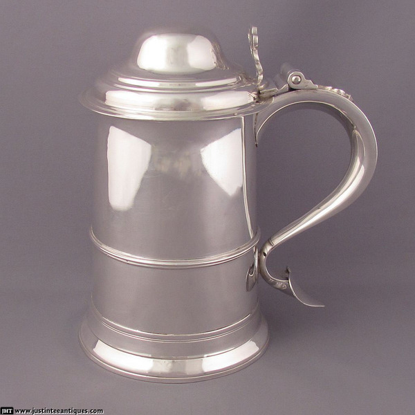 A George III sterling silver tankard by Samuel Godbehere & Edward Wigan, hallmarked for London, 1791. Straight sided with domed lid