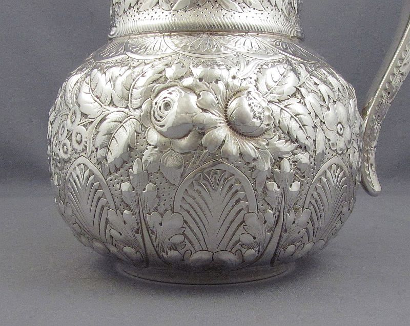 Antique American sterling silver water pitcher (or water jug) with beautiful repoussé floral decoration by Gorham of