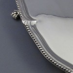 A large George III silver salver by John Carter II, London 1774. With bead edge and ball and claw feet