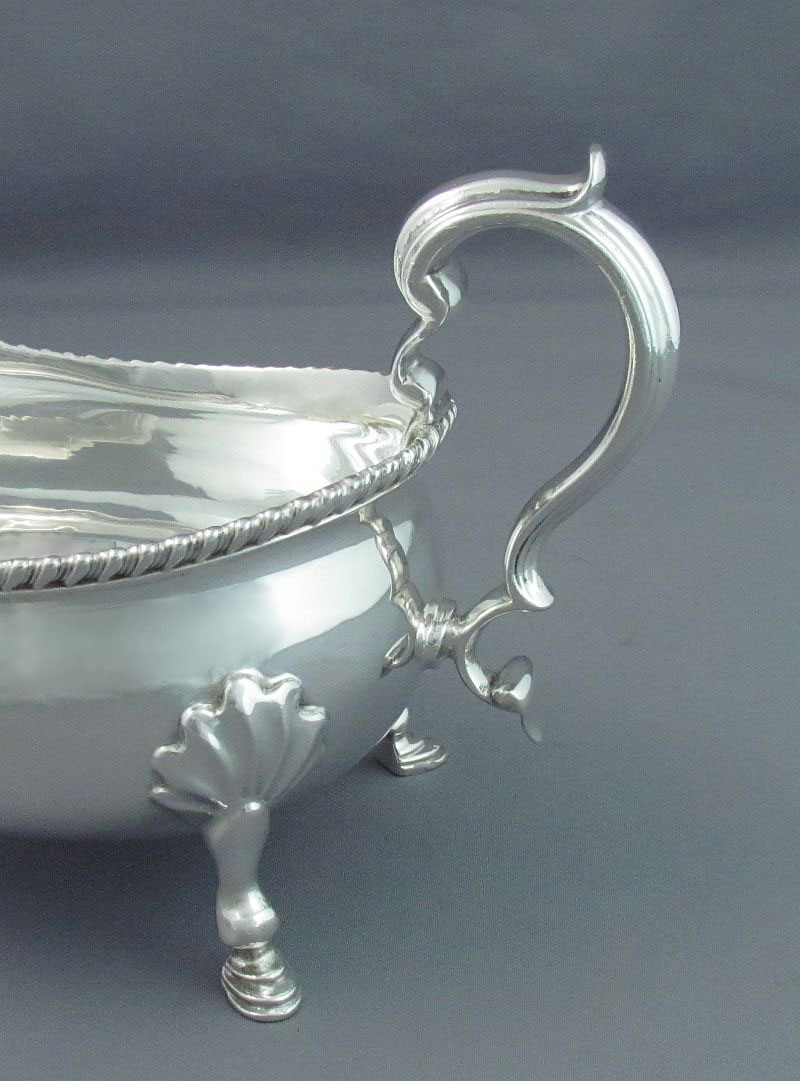 A pair of large Edwardian sterling silver sauce boats by Thomas Bradbury & Sons, hallmarked London 1910. Traditional boat shape