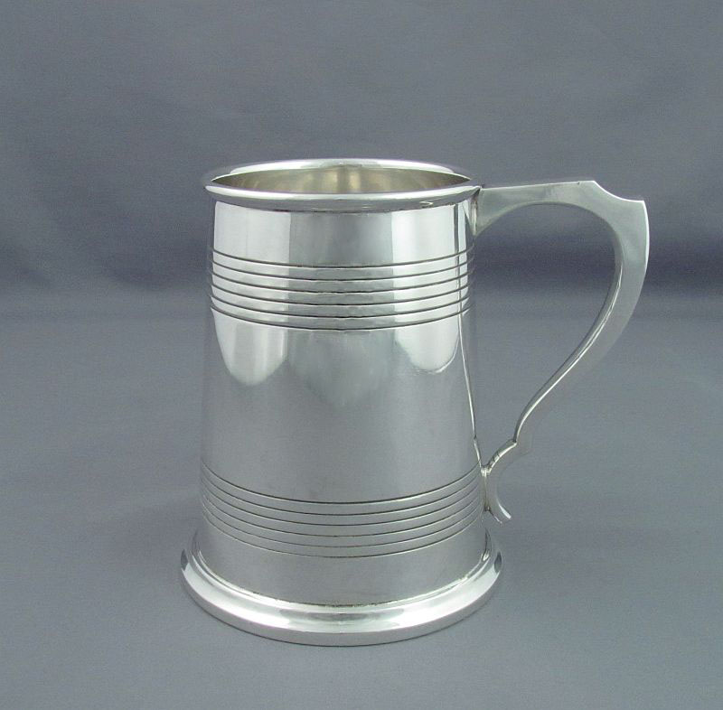 English sterling silver mug by James Dixon & Sons, hallmarked Sheffield 1945. Tapered cylindrical shape with tau shaped