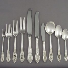 An extensive sterling silver flatware set for 12 in Rosepoint pattern by Wallace comprising: