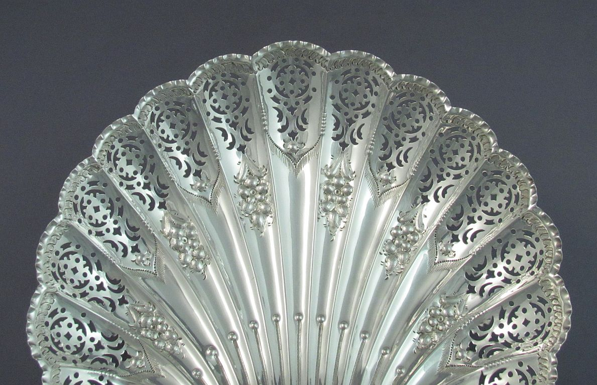 A pretty Victorian sterling silver dessert dish by Henry Atkins, hallmarked Sheffield 1898. Pierced scallop shell design with repoussé
