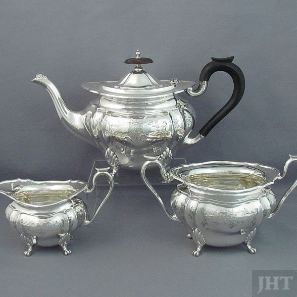 A George V sterling silver tea set by William Suckling Ltd, hallmarked Birmingham 1925. Oval shape with fluting and engraved