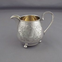 A Russian silver cream jug hallmarked Moscow 1885 (maker's mark mis-struck), also marked with post revolution Latvian mark.