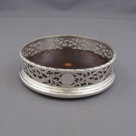 A rare Edwardian sterling silver wine coaster by Carrington & Co, hallmarked London 1910. Neoclassical style, pierced