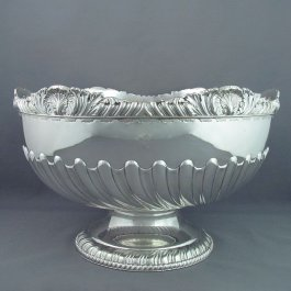 A late Victorian sterling silver punch bowl by Henry Atkin, hallmarked, Sheffield 1894. Half fluted hemispherical body