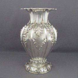 A large Italian .800 silver vase c. 1950, with French import mark.  Urn shaped with everted rim and spreading foot, embossed with baroque