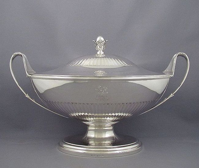 A handsome George III silver soup tureen by John Wakelin & William Taylor. Neoclassical style, oval on spreading foot