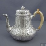 An assembled Victorian sterling silver tea set, the teapot by Robert Garrard II, hallmarked London 1838, the cream and sugar