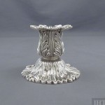 A pair of Tiffany Chrysanthemum sterling candlesticks New York, c. 1950. Solid cast construction with detailed Chrysanthemum