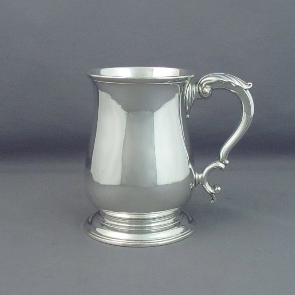 A fine quality early George III silver pint mug by John Swift, London 1761. Baluster shaped on ring foot with acanthus capped