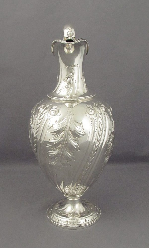 A pretty Victorian sterling silver claret jug (or wine ewer) by Richard Martin and Ebenezer Hall, Sheffiled 1889. Urn shaped
