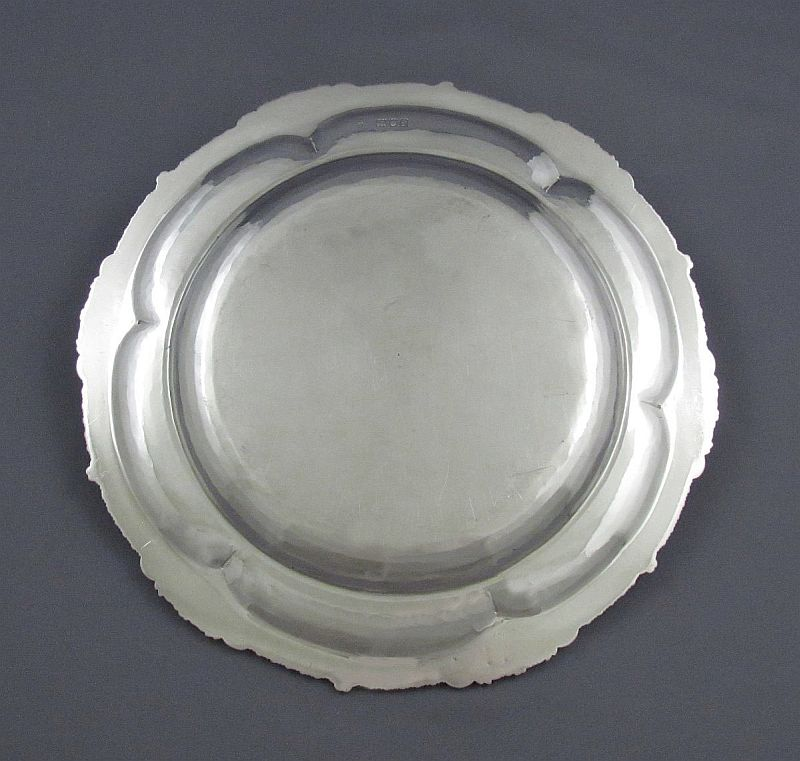 """A superb set of 12 handmade Edwardian silver dinner plates by Francis Higgins, hallmarked London 1901. Hand raised in shaped circular form with fine applied shell, acanthus and gadroon border, each engraved in the centre with the Royal Arms of Greece. 10.25"""" (26cm) in diameter, 245.6 troy oz (7638g)."""