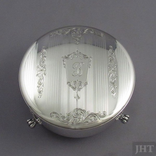 A sterling silver jewellery box by Henry Birks & Sons, Montreal 1959. Circular with acanthus capped paw feet