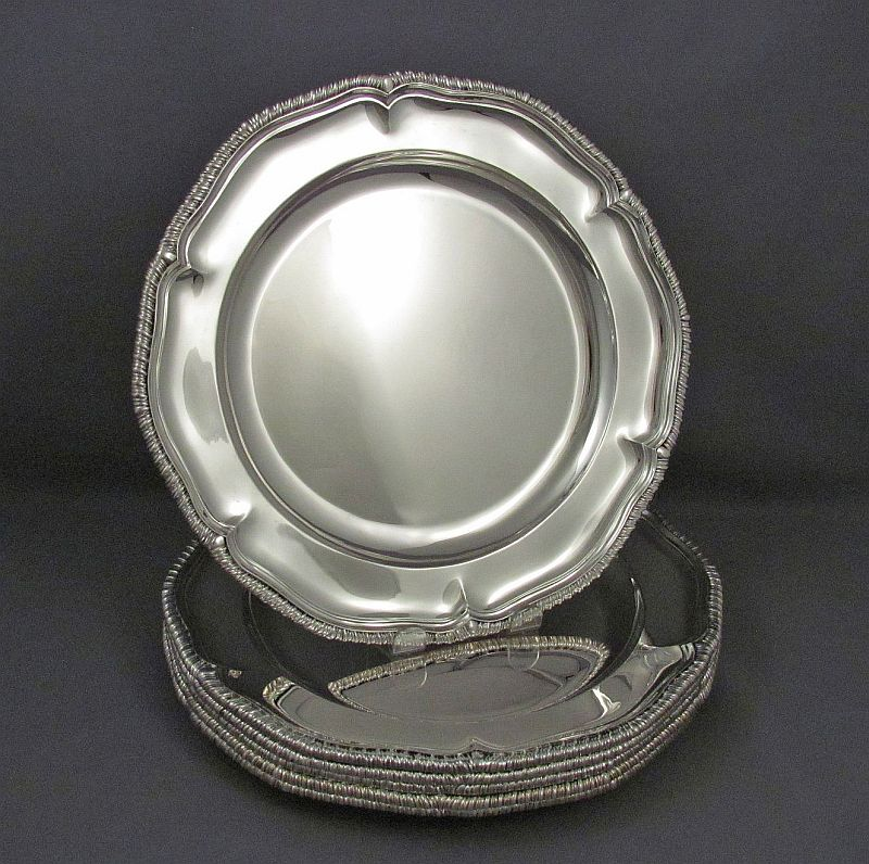 A fine quality set of 6 large hand raised sterling silver dinner plates by Asprey & Garrard, hallmarked London 2000.