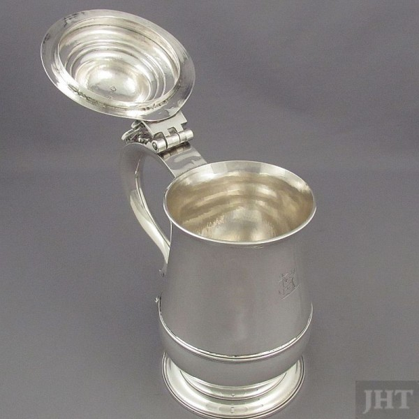 A fine quality early George III silver tankard by William Cafe, hallmarked London 1761. Baluster shaped with domed lid