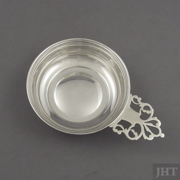 A sterling silver porringer by S. Kirk & Son, Baltimore c 1950, pierced side handle.