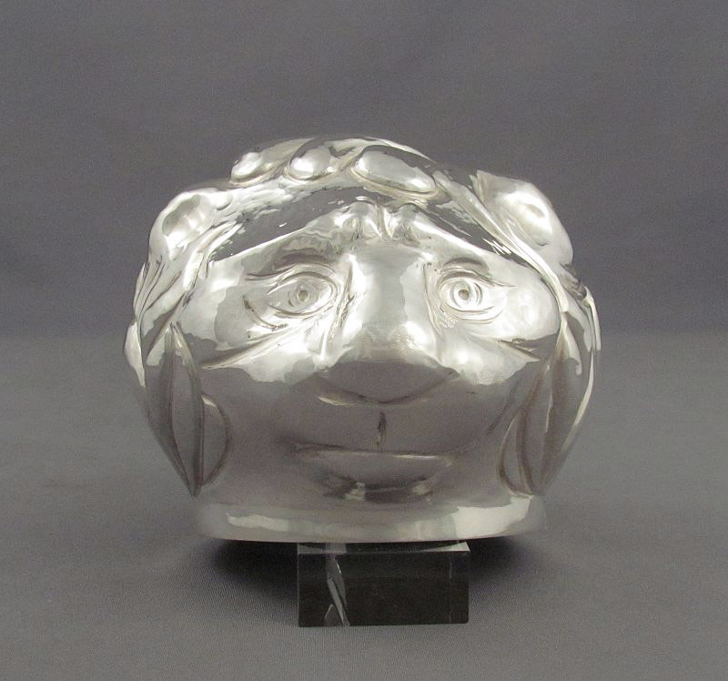 A superb sterling silver stirrup cup, hand raised from a single sheet of silver in the form of a lion by Canadian silversmith