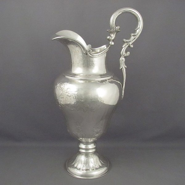 A large American coin silver water pitcher by Baldwin Gardiner, New York c. 1830. Inverted baluster shape, scroll handle