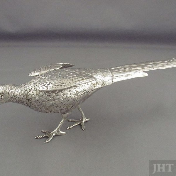 A pair of sterling silver pheasants, continental c. 1950. Vintage silver table ornaments realistically modeled in the