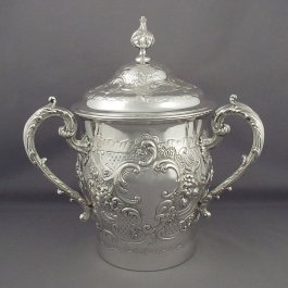 A Victorian sterling silver cup & cover by William Comyns, hallmarked London 1892. Rococo style, with three acanthus