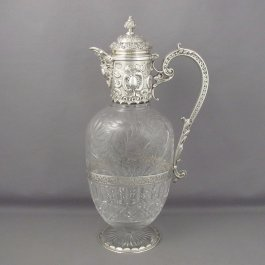 A fine quality Victorian sterling silver claret jug by Elkington & Co, hallmarked for London 1895. The cut crystal body is oval on circular