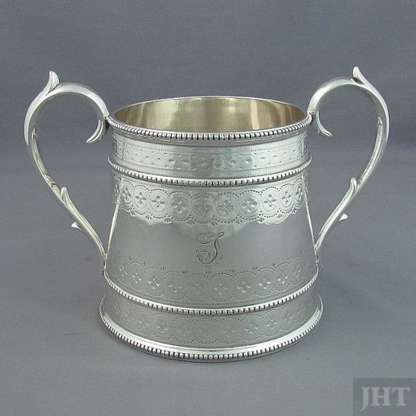 A four-piece Victorian sterling silver tea service by Edward & James Barnard, hallmarked for London 1872. Tapered