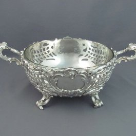 A fine quality sterling silver serving bowl by Gebruder Friedlander, Berlin c. 1900. Hemispherical shape with pierced body