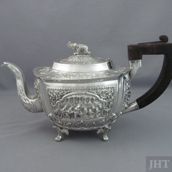 A fine quality Burmese silver tea set Rangoon c. 1900 with retail mark for Coombes Company. Oblong shaped teapot with elephant finial