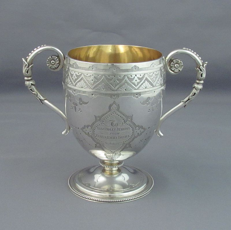 A fine Victorian sterling silver christening set by Thomas Smily, hallmarked London 1869. The set includes a Christening cup