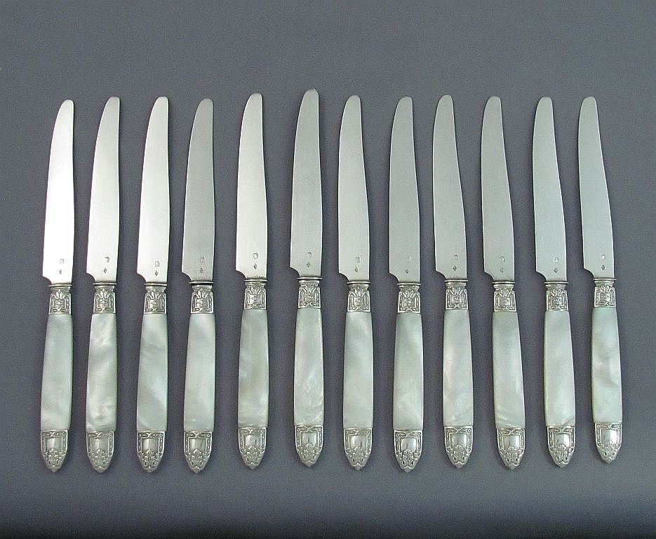 A set of twelve French .800 silver dessert knives, maker PF, c. 1900. Silver blades with mother of pearl handles
