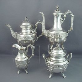 A French .950 silver four piece tea set by Charles Folliot, Paris c. 1890. Comprising a teapot, coffee pot, cream jug and lidded sugar bowl.