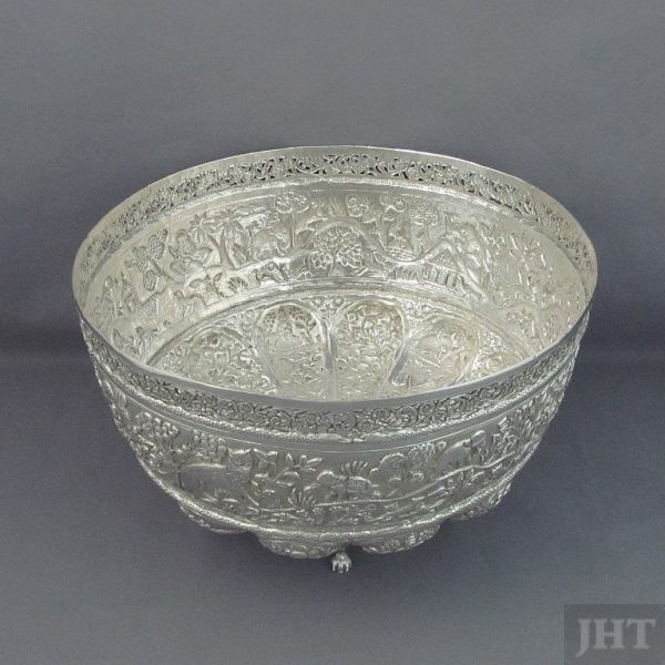 An Indian silver punch bowl, Lucknow c. 1900. Embossed and chased in fine detail in the Hunting pattern. Pierced rim