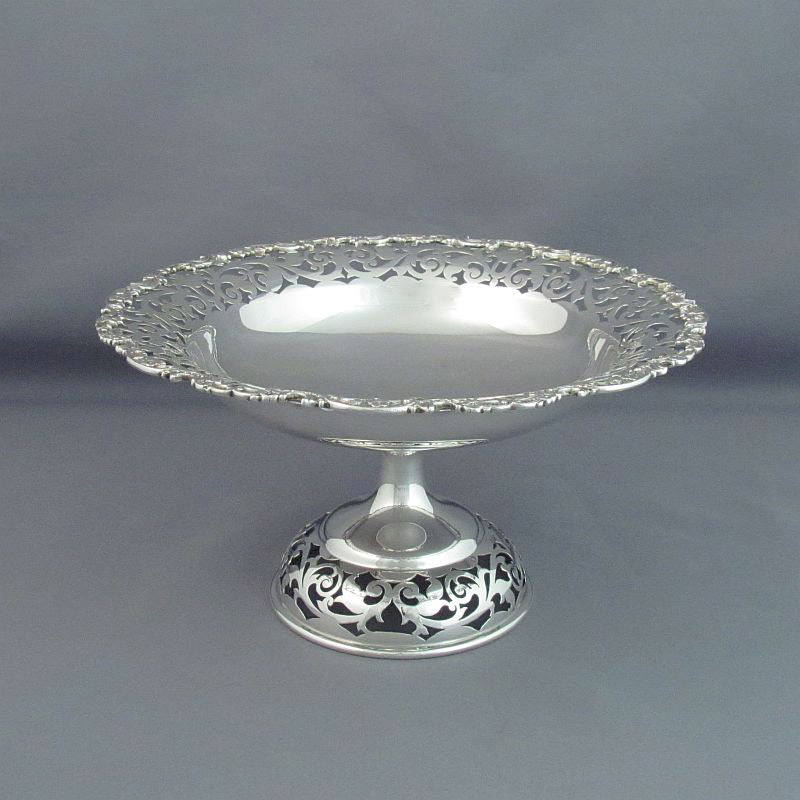 A sterling silver comport by Henry Birks & Sons, Montreal c. 1925. Circular shape on pedetal foot with piercing and applied flower