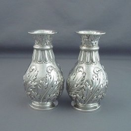 A pair of fine quality Edwardian sterling silver vases by Lambert & Co, hallmarked London 1908. Each baluster shaped on ring foot