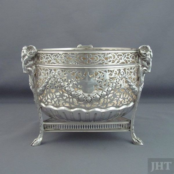 A fine quality Edwardian sterling silver bowl by Nathan & Hayes, hallmarked Chester 1909. Pierced circular body on three rams mask