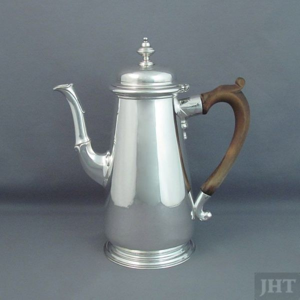 A fine quality George II silver coffee pot by Edward Feline, hallmarked London 1738. Tapered cylindrical shape with domed