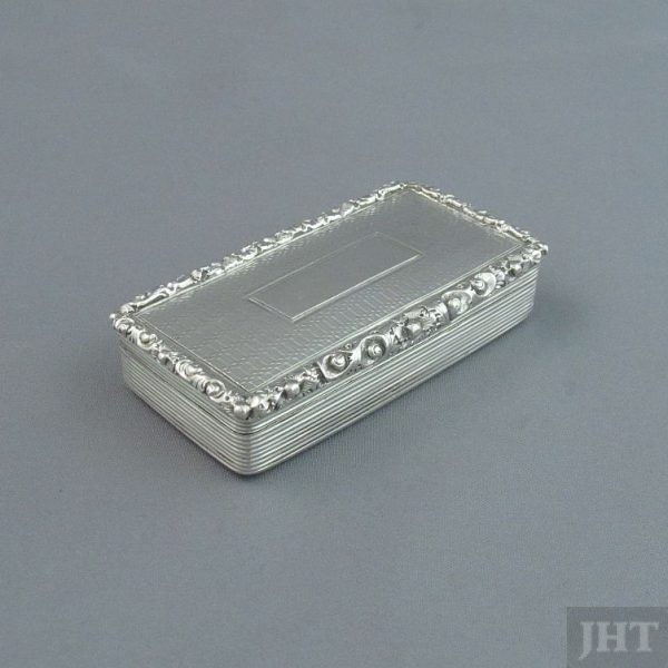 A William IV silver snuff box hallmarked Birmingham 1836 by Edward Smith. Rectangular with engine turned exterior, applied