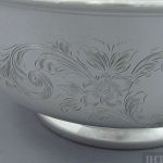 A Birks sterling silver rose bowl, Montreal 1939. Circular shape on pedestal foot, with hand engraved decoration and molded