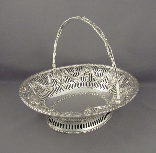 A fine quality George III style sterling silver basket (for cake or fruit) in neoclassical style by Crichton Brothers, hallmarked London
