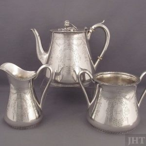 A fine quality American antique sterling silver tea set by Tiffany & Co., New York c. 1860, comprising a teapot, cream jug