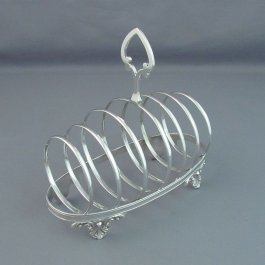 A large sterling silver toast rack, probably American c. 1900. Unidentified maker's mark C.A.O. Oval base on stylized