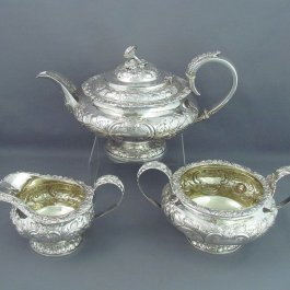 A large antique George IV silver tea set by Thomas Austin, hallmarked London 1824. Compressed circular shape