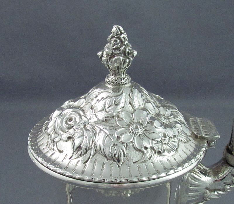 Kirk Repousse sterling silver coffee set, Baltimore c. 1940. Baluster shape with scroll handle and spout, embossed and chased
