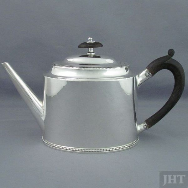A George III silver teapot by Hester Bateman, hallmarked London 1782. Drum oval shape with domed lid, straight spout