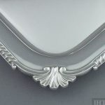An antique English sterling silver tea tray, maker's mark JSS, hallmarked London 1939. Rectangular with gadroon border