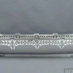 An unusual English sterling silver bread dish by Fattorini & Sons, hallmarked Birmingham 1919. Oblong with cut corners