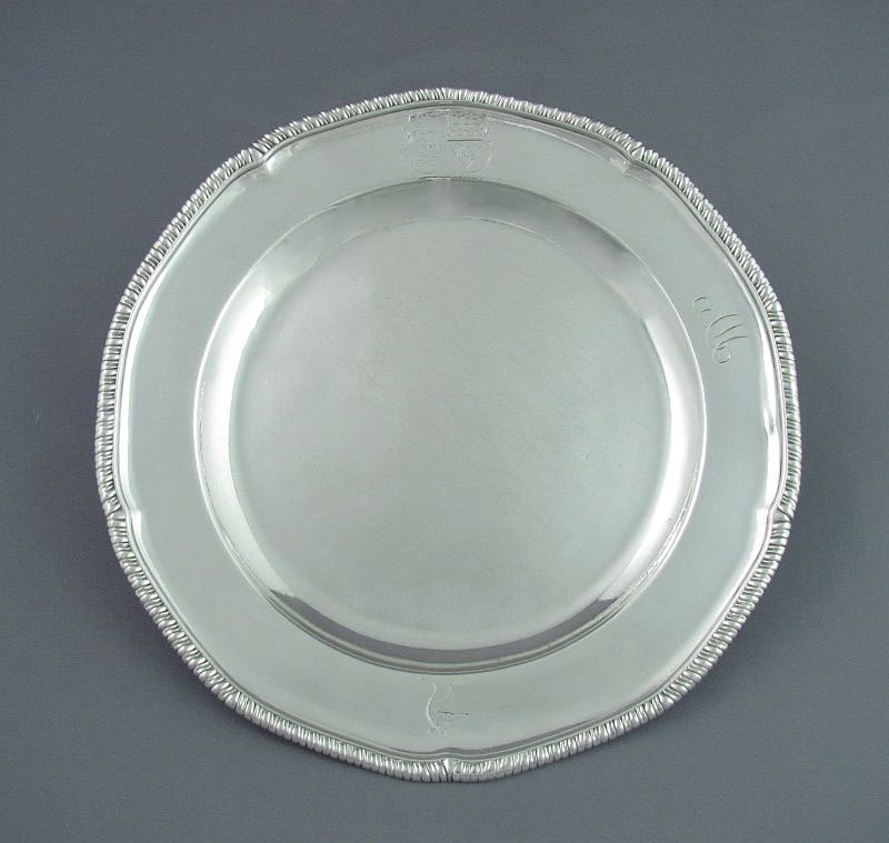 A George III silver dinner plate by renowned silversmith John Schofield, hallmarked London 1778. Circular with shaped